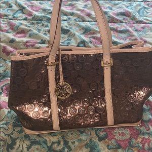 Beautiful copper colored Michael Kor Bag